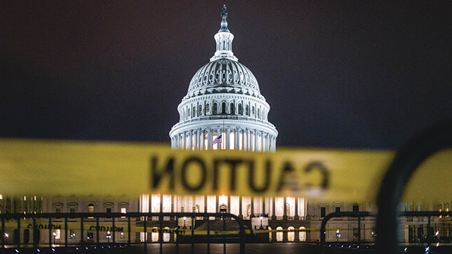 The U.S. capitol building with a caution tape across the entry.