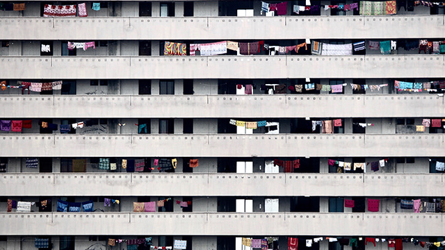 A crowded apartment building with floors of laundry in Bangladesh.