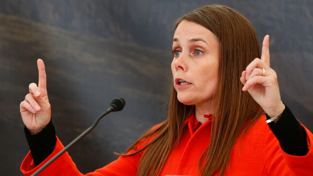Icel和's Prime Minister Katrin Jakobsdottir gestures at a news conference.
