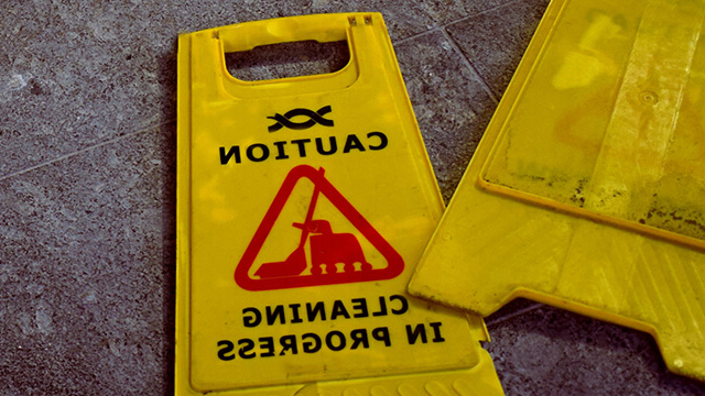 Custodial services floor sign reading 'Caution Cleaning in Progress.'