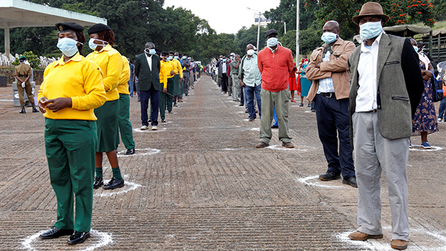 Workers in Nairobi, Kenya line up observing social distancing amid concerns about the spread of coronavirus disease.