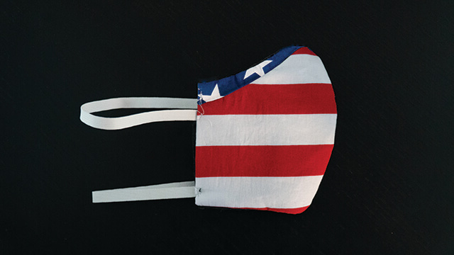 Protective mask made from American flag-like fabric.